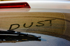 Dust Word handwriting on the dust Royalty Free Stock Image