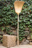 Dustbin and broom straw. Stock Images