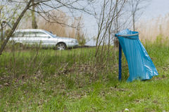 Dustbin in the park. Littering. Dustbin in the park, garbage can. Littering. Car in park zone Royalty Free Stock Images