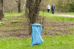 Dustbin in the park. Littering. Royalty Free Stock Photography