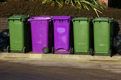 Dustbins 01. A row of purple and green waste-bins in Liverpool Stock Photos