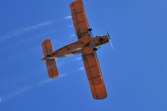 Duster airplane on clear blue sky bottom view Royalty Free Stock Photo