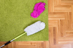Duster and loth on the carpet Stock Photo