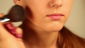Dusting face closeup stock footage