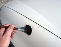 Dusting for fingerprints. Using fingerprint powder on a vehicle to locate latent fingerprints royalty free stock images