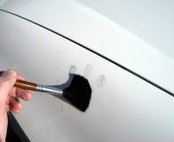 Dusting for fingerprints. Using fingerprint powder on a vehicle to locate latent fingerprints Stock Photos