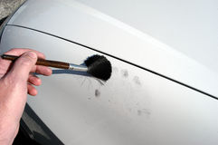 Dusting for fingerprints. Stock Images