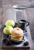Dusting with icing sugar over apple fritters Royalty Free Stock Photos