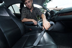 Dusting inside the car Stock Images