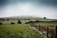 A dusting of snow. A hill and fields with a light dusting of snow Royalty Free Stock Photo