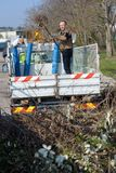 Dustman cleaning lorry bin Stock Photos