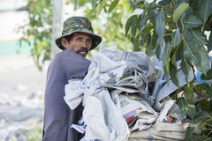 Dustman puts papers in the garbage bag Royalty Free Stock Image