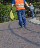 Dustman walking Royalty Free Stock Image