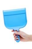 Dustpan εκμετάλλευσης χεριών Στοκ φωτογραφία με δικαίωμα ελεύθερης χρήσης