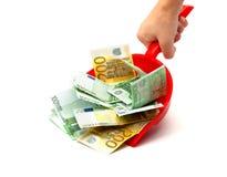 dustpan χρήματα χεριών Στοκ φωτογραφίες με δικαίωμα ελεύθερης χρήσης
