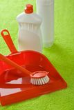 Dustpan brush and bottles Stock Photography