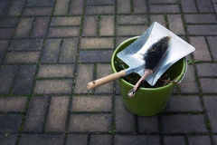 Dustpan, brush and bucket outside on pavement Royalty Free Stock Photography