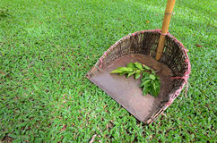 Dustpan in garden Stock Photos