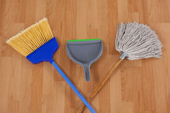 Dustpan, sweeping broom and mop Stock Photo