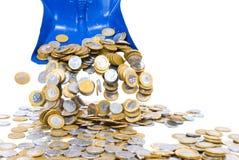 Dustpan throwing money Royalty Free Stock Image
