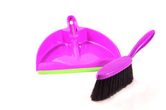 Dustpan and violet brush Royalty Free Stock Image