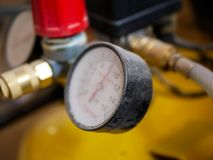 Dusty air compressor manometer close up shot. Shallow depth of field stock photo