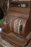 Dusty Antique Cash Register. A dusty old wooden cash register that is now retired Royalty Free Stock Images