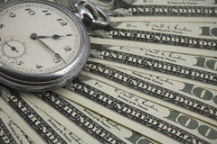 Dusty antique pocket watch on US currency Stock Image