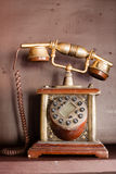 Dusty antique telephone. A dusty antique telephone, Retro Revival Stock Photo