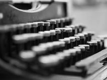 Dusty antique typewriter with focus on the keys in black and whi royalty free stock images