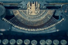 Dusty antique typewriter with focus on the type guide. With a retro feel royalty free stock images