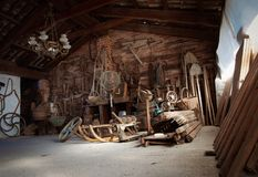 Dusty attic with old rusty objects stock image
