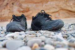 Dusty black shoes Stock Image
