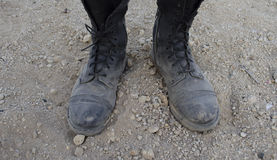 Dusty boots. In a gritty desert Royalty Free Stock Photos