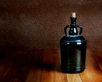 Dusty bottle on a wooden table vintage Royalty Free Stock Photography