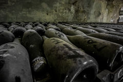 Dusty bottles of sparkling wine Royalty Free Stock Photo