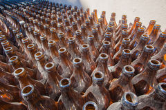 Dusty Brown Beer Bottles Stock Images