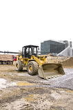 Dusty bulldozer parked on the construction site Royalty Free Stock Images