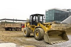 Dusty bulldozer parked on the construction site Stock Image