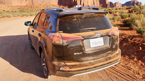 Dusty car in the desert. Royalty Free Stock Photos