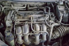 Dusty car engine parts with different tubes. Close up. Detail shot stock photography