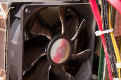Dusty computer CPU fan on an old motherboard. Royalty Free Stock Photos