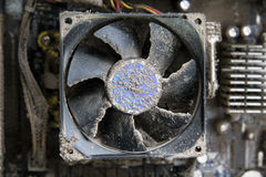 Dusty cooler. Dusty CPU cooler on dusty motherboard, very dusted computer Royalty Free Stock Photo