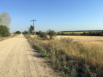 Dusty country road. Dusty road near the village of Izvorălu, Mehedinți county, Romania Stock Photography