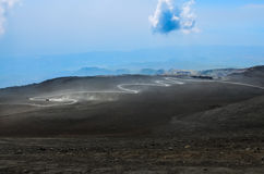 Dusty curvy road on Etna volcano, Sicily Stock Photos