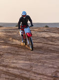 Dusty desert racer on a motorcycle Royalty Free Stock Photo