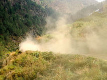 Dusty Dirt Road. A dusty dirt road in the mountains royalty free stock photography