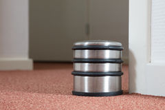 Dusty doorstop in a modern house. Selective focus royalty free stock photo