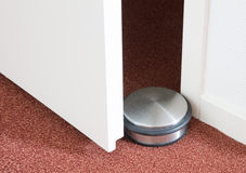 Dusty doorstop in a modern house. Selective focus royalty free stock image