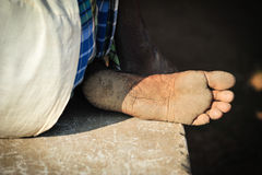 Dusty foot. Dusty barefoot in the sunlight, India Stock Image